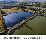 Zabie Doly, park between Bytom and Chorzow in Poland. Autumn colors landscape aerial view. Lake path causeway.