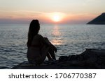 Silhouette Of A Young Girl At...