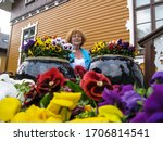 Grandmother Plants Flowers In ...