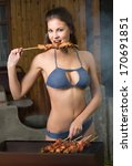 Girl Cooks Meat On A Barbecue...