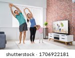 family doing online stretching... | Shutterstock . vector #1706922181