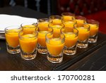 Pumpkin soup in shot glasses served at a banquet