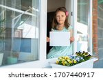 a child girl from the window... | Shutterstock . vector #1707440917