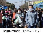 Small photo of Apucarana / Parana / Brazil - April 19, 2020 - Movement at the open market on Saturday morning in Apucarana. People all wearing a mask, to protect themselves from covid-19, coronavirus