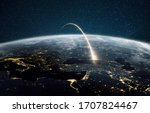 Small photo of Rocket launch on a night planet earth with lights. Concept of successful satellite launch. Spaceship flies over the planet. View from space