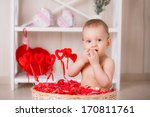 beautiful little boy sits among ... | Shutterstock . vector #170811761