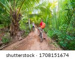 Tourist Couple Riding Bicycle...