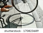 Woman with bike waiting for green light - stock photo