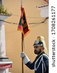 Small photo of Lisbon, Portugal-April 2019: Close up of one of the members of the Mounted platoon with banner in hand in front of the Belem National Palace for the changing of the guards