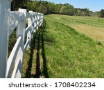 Long White Post And Rail Fence...