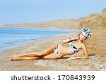 beautiful woman on the beach  ... | Shutterstock . vector #170843939