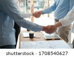 businessman shaking hands with...