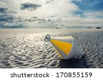 A White Yellow Buoy At The...