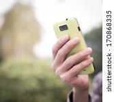 using cell phone   Shutterstock . vector #170868335