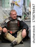 Small photo of Reenactor dressed in armor of an Old Russian footman taking break after fight reconstruction. October 11, 2019. Kiev, Ukraine