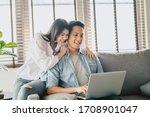 Happy Asian Couple Using Laptop ...