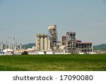 Oil Refinery Plant surrounded by Farmland - stock photo