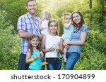 happy young family with four... | Shutterstock . vector #170904899