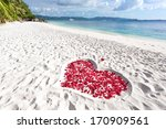 Stock photo heart of roses petals on tropical sandy beach nobody love concept 170909561