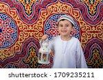 Happy Young Boy Celebrating...