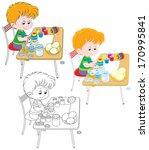 little boy coloring easter eggs ... | Shutterstock .eps vector #170995841