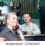 girl with old phone in a bar | Shutterstock . vector #17101462