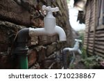 Small photo of White water tap beside the slum. Slum dweller take water from here.