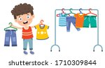 little kid and colorful clothes | Shutterstock .eps vector #1710309844