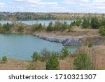 Small photo of Kalush, Ukraine, 2020: The abandoned and flooded quarry of potash salts in an offhand manner.