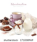 Ingredients for hot chocolate with marshmallow on a white background. - stock photo