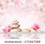Spa Stones And Pink Flower On...