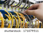 woman connecting network cables ... | Shutterstock . vector #171079511