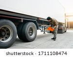 Asian Truck Driver Holding...