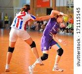 Small photo of GALATI, ROUMANIA - MAY 18: Unidentified players in action at Roumanian Handball National Championship . match (HC Danubius Galati vs.HC Roman) May 18, 2013 in Galati, Roumania.
