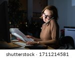 Woman In Glasses Using...