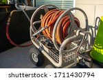 rolled up water hose on a... | Shutterstock . vector #1711430794