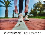 Fitness woman ties shoelaces on ...