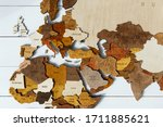 Wooden world map on a white background. Handmade. Plywood. In brown tones. The countries of Europe, Asia, the Middle East and South Africa. Mediterranean Sea. Top view. Tourism and travel. Woodwork.
