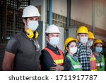 Small photo of Industrial engineer worker women and men wearing helmet and mask in line waiting to work together at manufacturing plant factory, young people working in industry