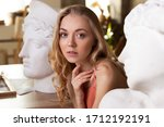 Young Blonde Woman Sitting...