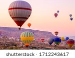 Small photo of Colored balloons at dawn smack over the valley.