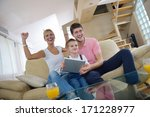 happy young family using tablet ... | Shutterstock . vector #171228977
