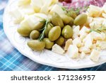 Cheese And Olives On A Plate A...