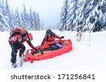 Ski Patrol With Rescue Sled...