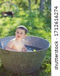 Little Baby Bathes In A Vintag...