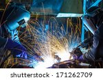 Teamwork In Welding Steel