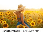 Young Girl In A Field With...
