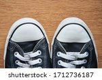 black leather sneakers on a... | Shutterstock . vector #1712736187