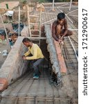 Small photo of Banda, Uttar Pradesh/India - March 06 2020 : A daily wage worker doing his daily job at a construction site. These workers usually work on adhoc basis without any contractual agreement with anyone.