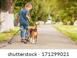 Stock photo little boy walking with his beagle puppy better friend 171299021